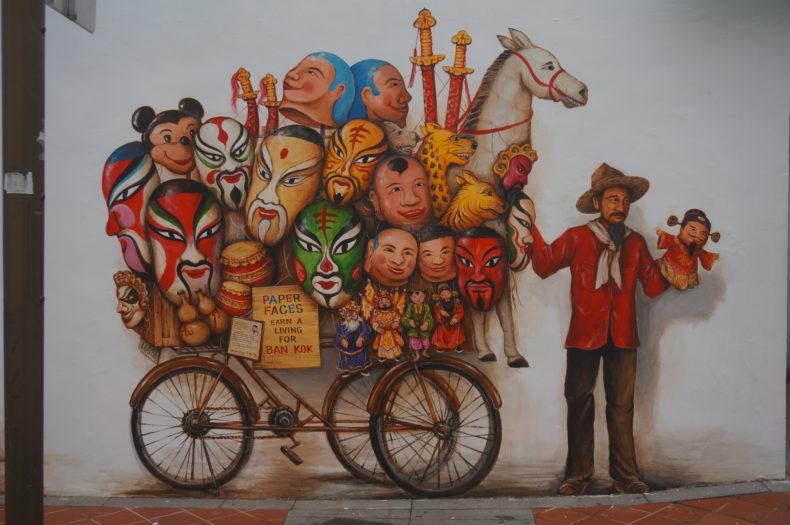 Street-art à Singapour représentant un marionettiste ambulant
